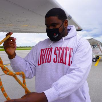 Image of Jordan Griffith-Simmon tying aircraft rope